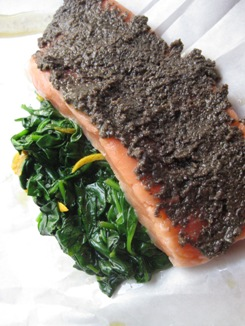 Tapenade Salmon en Papillote over Orange Spinach before baking